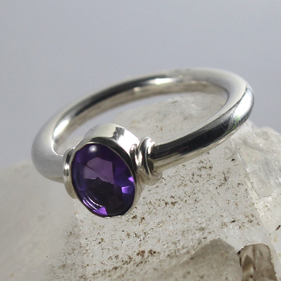 amethyst facet with silver tube setting