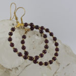 large round earrings with rhodolite garnet and gold
