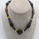 Ethiopian ebony inlaid bead with African glass trade beads and wax beads