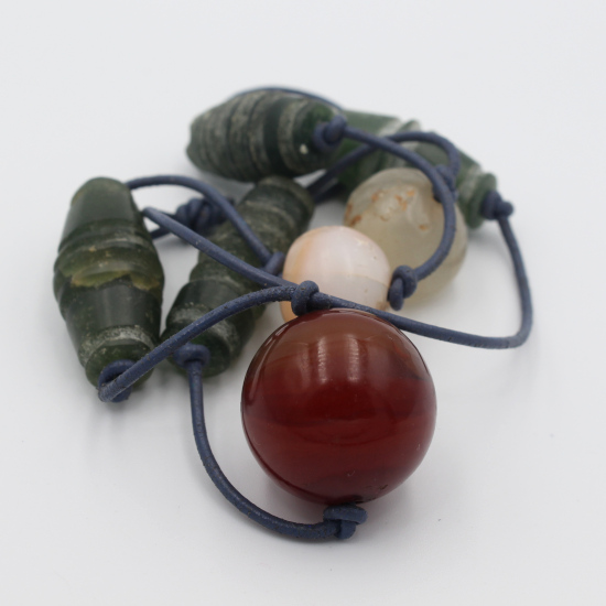 hand carved antique serpentine barrels with carnelian ball and antique afghan agate ball necklace