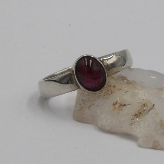 silver ring with garnet gemstone jewelry