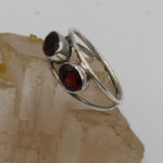 garnet facet silver ring with conjoining band