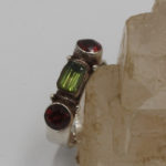 faceted peridot and garnet jewellery silver ring
