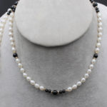 potato pearls and onyx long necklace with gold spacers