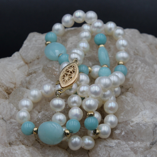pearl necklace with gold filigree clasp