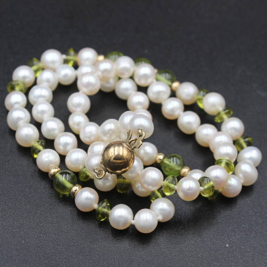 rolled gold clasp on cultured pearl and peridot necklace