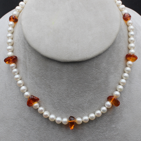 unique necklace with classic white round cultured pearls and amber beaded necklace